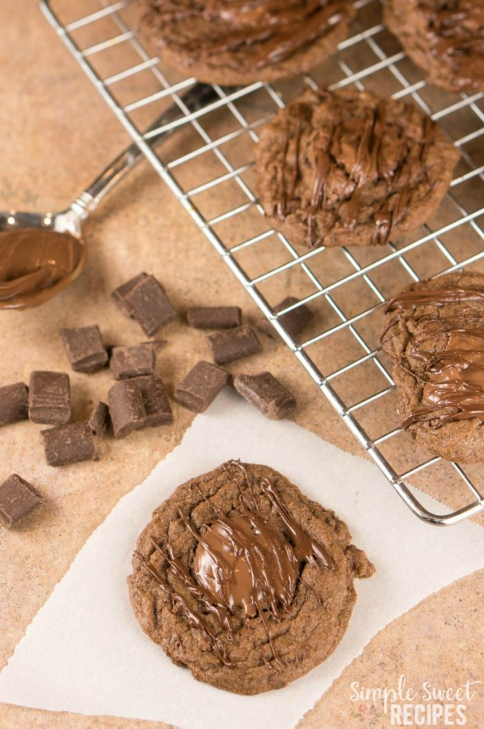 A bite of perfection in these Triple Chocolate Nutella Cookies. They are soft, chewy, creamy, chocolate overload cookies is a favorite treat dessert recipe..