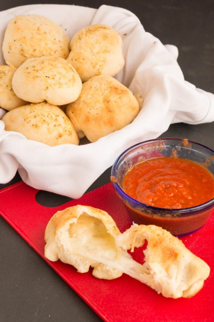 Your favorite garlic knots are all rolls up into these yummy Italian Cheese Rolls. So easy to make and delicious side to your pizza or pasta dinner.