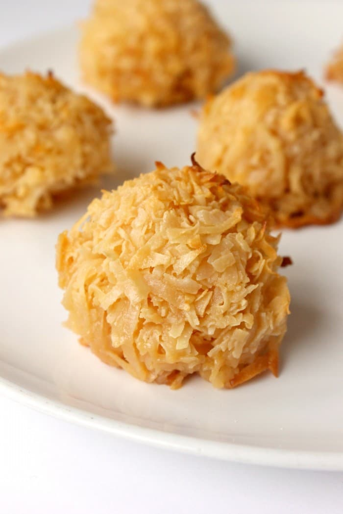 3 Ingredient Toasted Coconut cookies - oh my!! So addictive and good!! Drizzle with chocolate for a copycat Girl Scouts Samoas cookie recipe. 