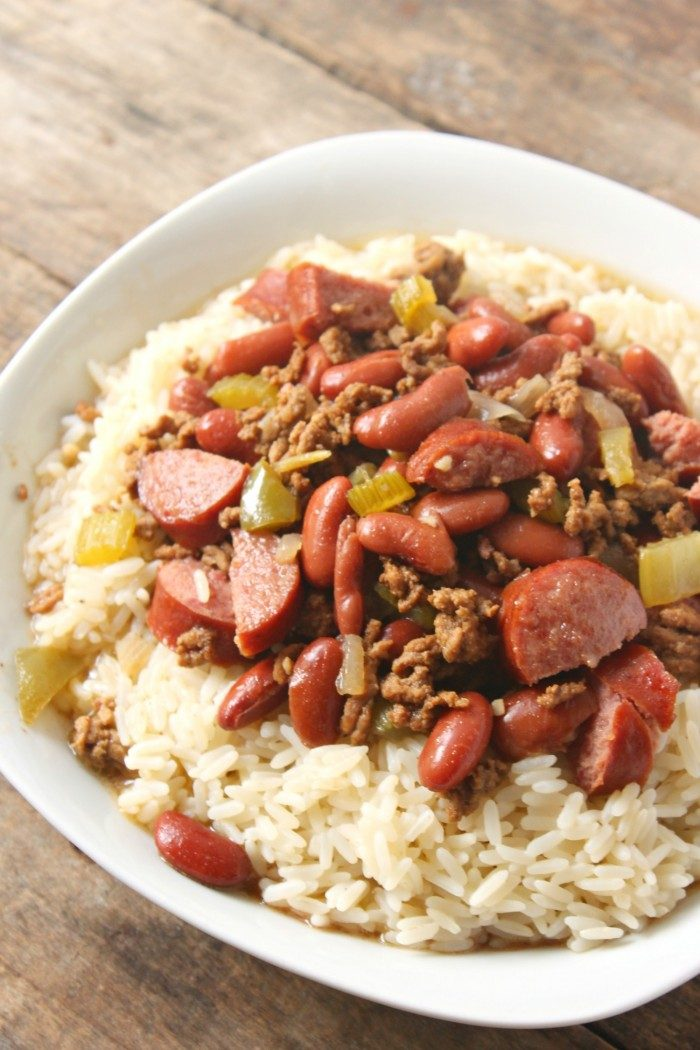Easy dinner recipe, this Louisiana influenced red beans and rice with ground beef recipe is hearty and filling with a flavorful Cajun taste that just needs a few minutes prep, then let it stew!