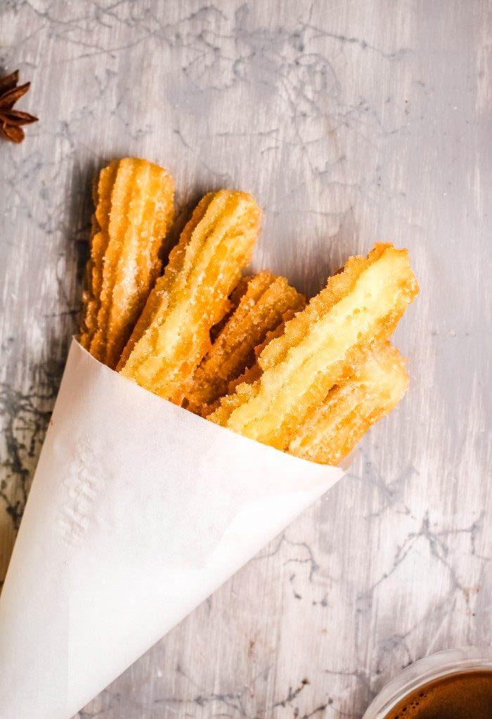cinnamon churros in paper cone