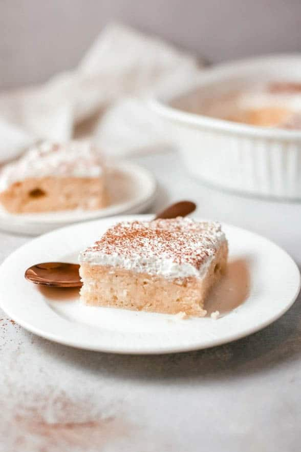 Tres Leches Poke Cake slice with spoon